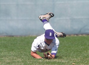 Tooele High School's Zach Jeffers dives to catch a ball in the outfield Wednesday against Grantsville.