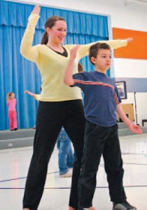 """Ahmed """"Medo"""" Benchehda, a second grader, does the mirror dance with Chauntelle Plewe. photography/Alleen Lang"""