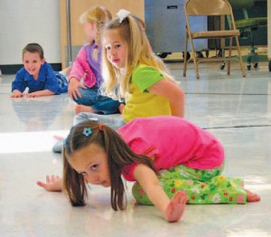 Kindergarteners Dace Sweat, Kaylee McWilliams, Camille Tripp and Leah Jolley show off their dance skills. photography/Alleen Lang