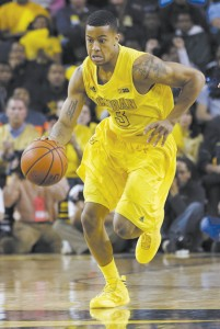 In this March 3, 2013, file photo, Michigan guard Trey Burke (3) dribbles upcourt during the first half of an NCAA college basketball game against Michigan State in Ann Arbor, Mich. Burke is a possible first round pick in the NBA Draft on June 27. (AP Photo/Carlos Osorio, File)