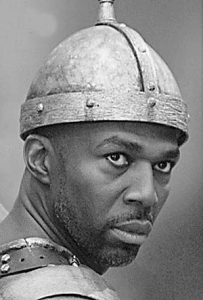Thurl Bailey as Goliath in Liken the Scripures Episode 3: One Smooth Stone.