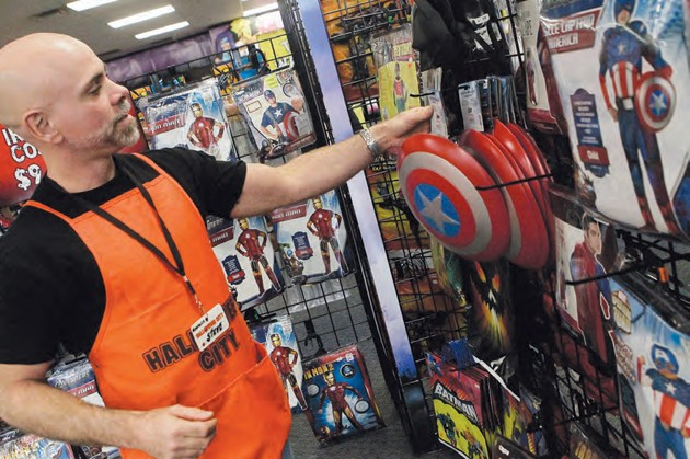 halloween city manager steve borges shows some of the kids superhero costumes at the store in tooele monday afternoon while superhero costumes were popular - Utah Halloween Stores
