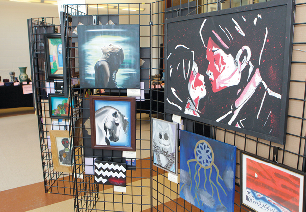 Local art students reveal their creativity in art show at THS