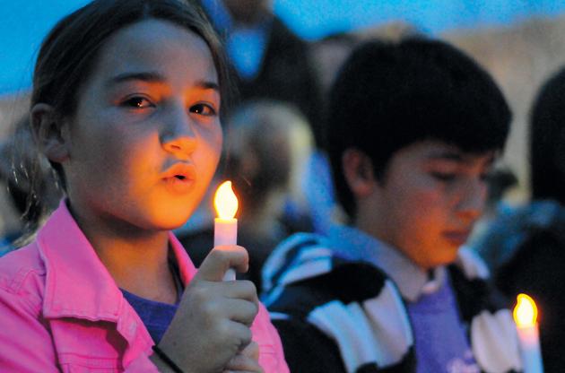 Victim advocates hold vigil to commemorate abuse awareness