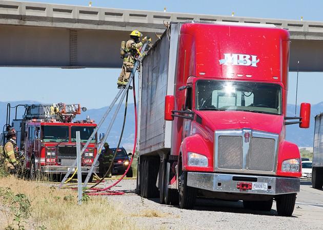 Smoldering trash in semitrailer requires firefighter response