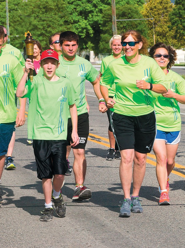 Police and Special Olympic athletes participate in torch run