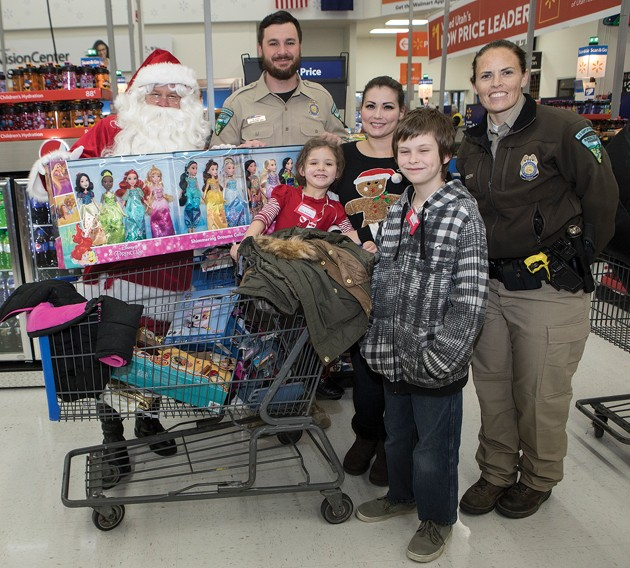 and her children sophia and ethan pose with santa and blm rangers mark gochis and tamson johnson at shop with a cop on saturday morning at walmart