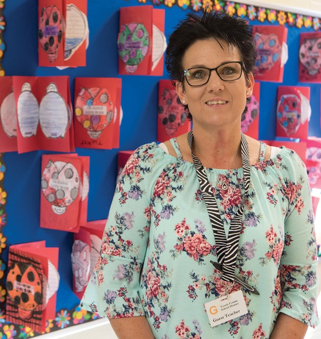 'Hugs' are the favorite part for new Guest Teacher of the Year