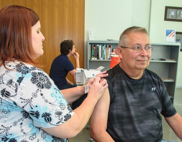 Health officials urge citizens to roll up sleeves for a flu shot