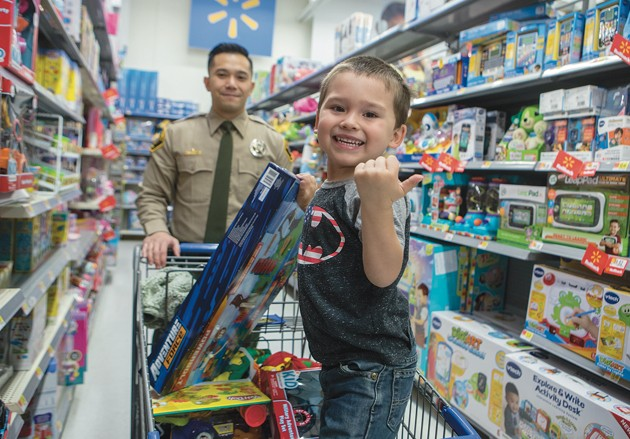 Over 100 kids receive Christmas cheer from county law enforcement
