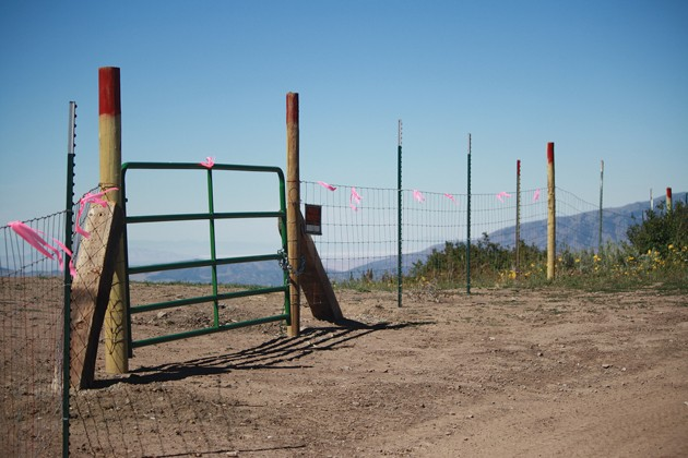 New gates on popular trail add fuel to heated dispute