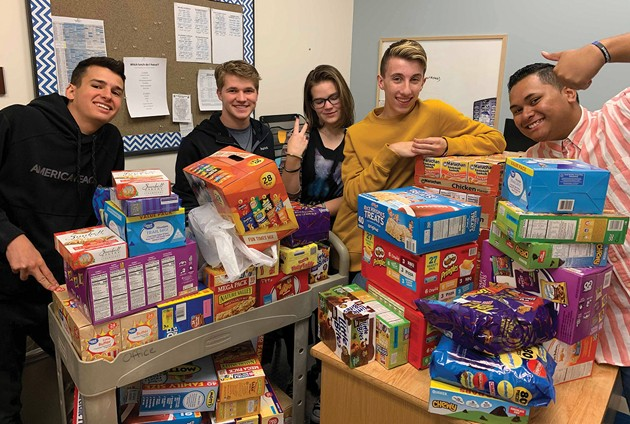 Students use friendly rivalry to feed hungry students