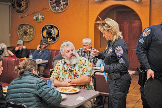 Officers serve up hot food at Casa Del Rey for Tip-A-Cop