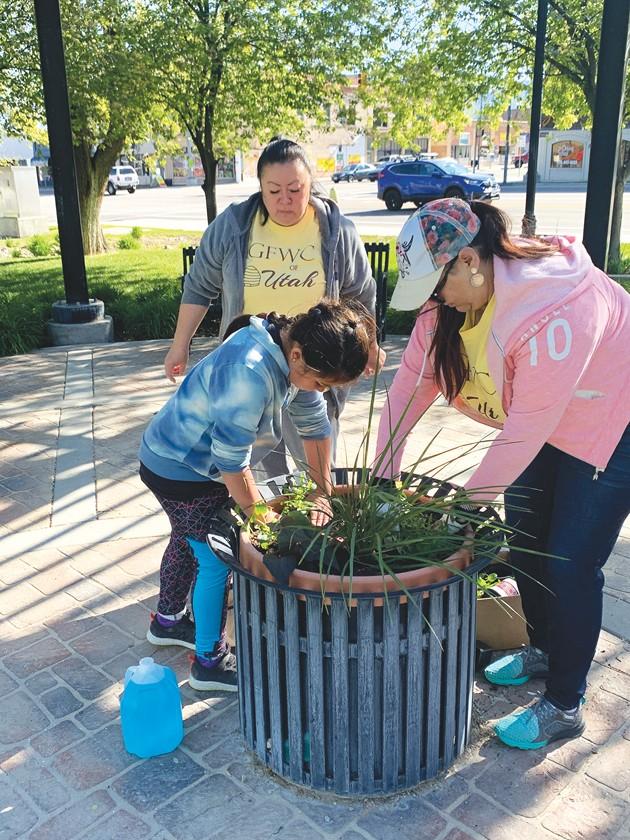 Ladies Community Club and Tooele Civic League plant flowers at Veterans Memorial Park